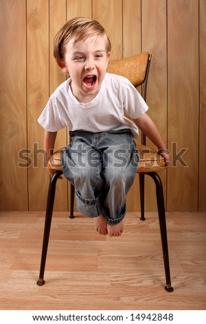 Boy throwing a tantrum while sitting on a timeout