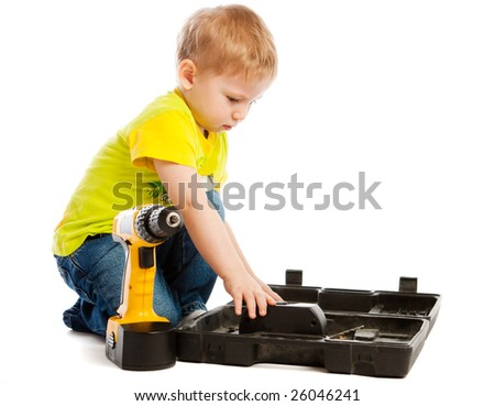 Boy, tools box and electric screwdriver, isolated