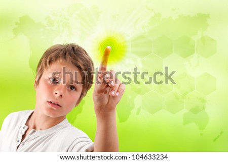 Boy touching futuristic green interface with green background and world map.