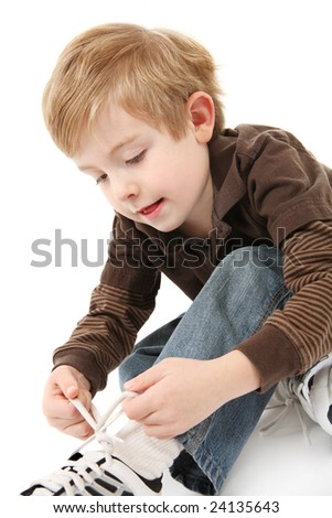 Boy tying his shoes
