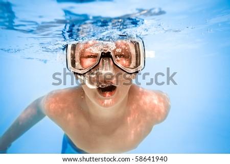 boy under water in pool