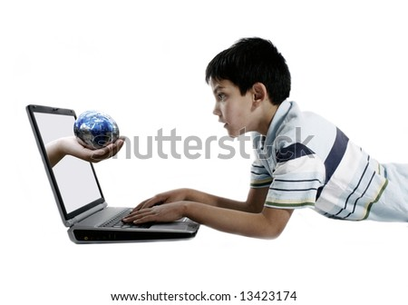Boy using laptop with hand coming out holding the earth puzzle