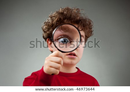Boy using magnifying glass