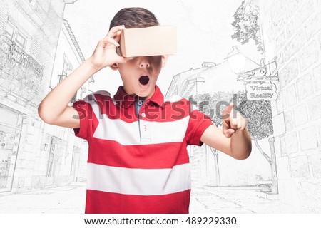 boy using virtual reality...