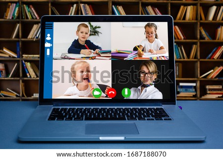 Boy video conferencing with tutor on laptop at home. Distance education concept.