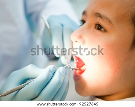 Boy visiting the dentist taking good care of his teeth