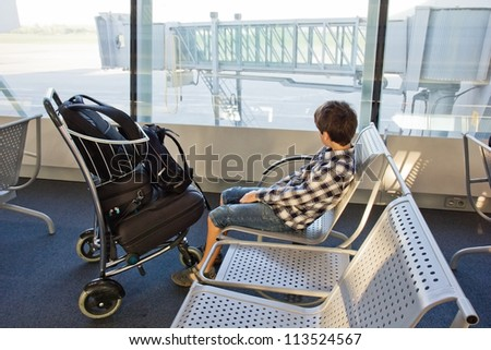 boy waiting for a plane in airport