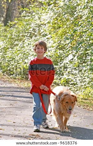 Boy Walking the Dog - stock photo