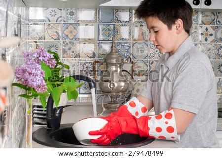 Picture of a Boy Washing Dishes Boy Washing Dishes