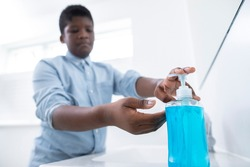 Boy Washing Hands With Soap At Home To Prevent Infection
