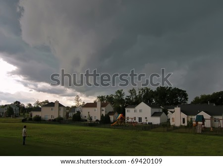 Boy watching massive storm cell approach
