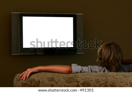 boy watching wide-screen television