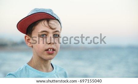 Boy wearing a cap