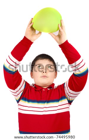 Boy who keeps a green balloon overhead, isolated over white background