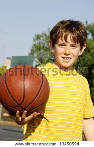 Boy with a ball in the park - stock photo