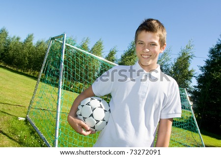 Boy with a football in hand