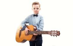 Boy with a guitar on a white background.