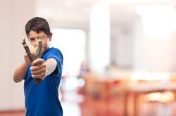 boy with a slingshot in school