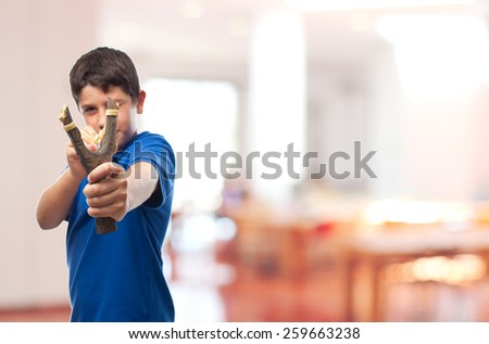 Shutterstock boy with a slingshot in school
