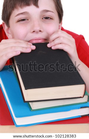 Boy with a stack of books