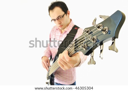 Boy with bass guitar and an amp