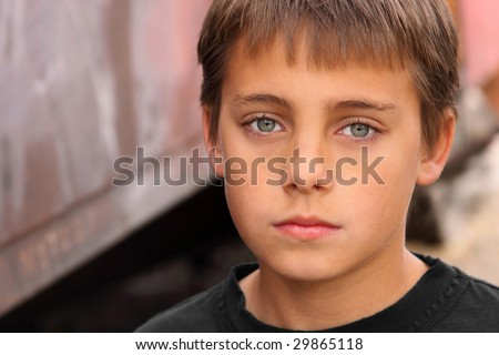 Boy with beautiful eyes against brown tones