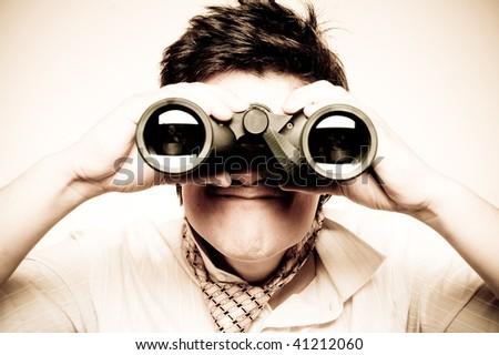 Boy with binocular. Retro style.