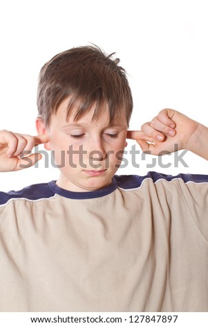 boy with closed ears on a white background