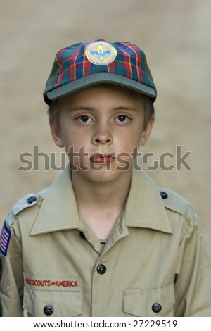 Boy with cub scouts uniform on