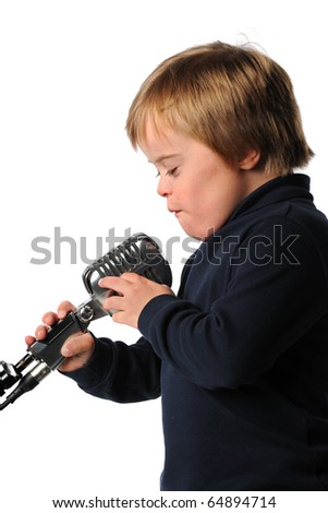 Boy with Down Syndrome singing into vintage microphone isolated over white background