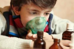 boy with electric inhaler as a curation against virul disease flue