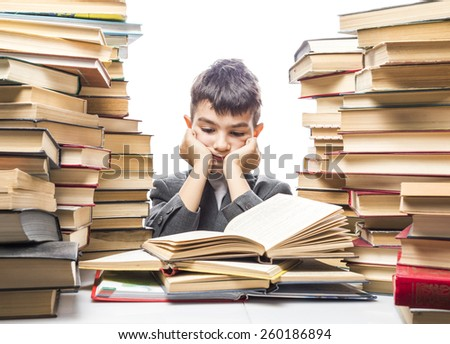 boy with enthusiasm reads the book in a vast body of literature