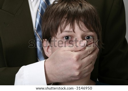 boy with face covered, concept of abuse and violence