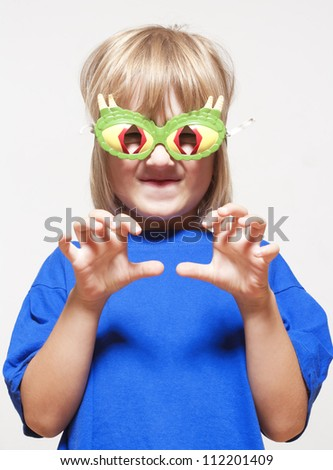 boy with funny glasses pretending to be a scary animal