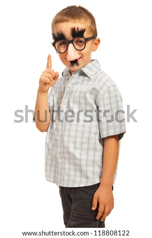 Boy with funny mask pointing up isolated on white background