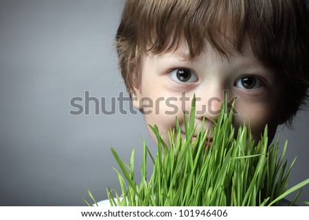 boy with grass, studio shot