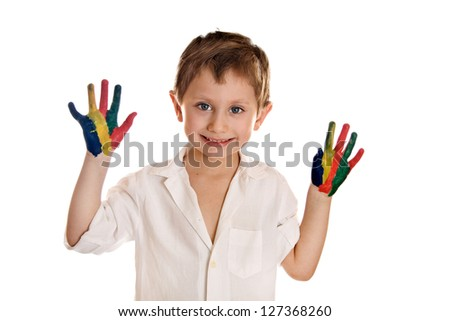 Boy with hands painted in colorful paints ready for hand prints isolated