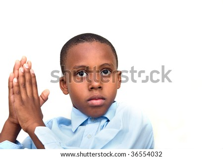 boy with hands together possibly praying