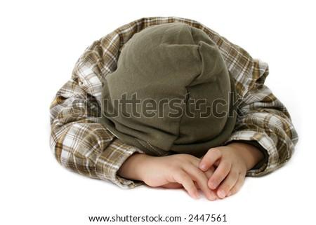 Boy with head down - stock photo