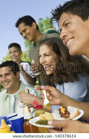Boy with his happy family having food on a picnic