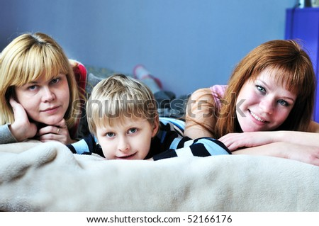boy with his older sister and mother - selective focus - stock photo