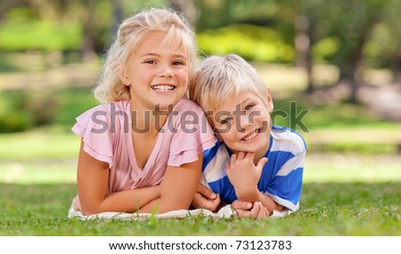 Boy with his sister in the park