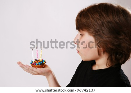 boy with little birthday cake