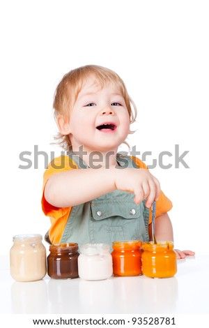 Boy with little jars of baby food