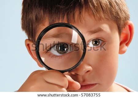 boy with looking glass