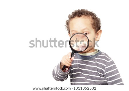 boy with magnifying glass ready to explore the world