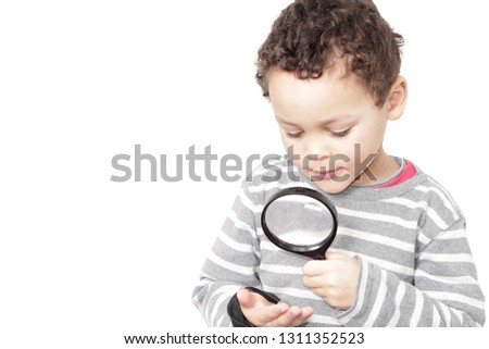 boy with magnifying glass ready to explore the world #1311352523