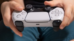 Boy with next gen controller in your hands