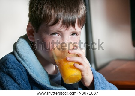 boy with orange juice in the morning