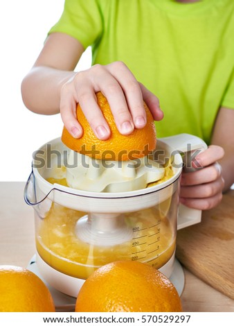 Boy with oranges makes the juice in a juicer isolated white #570529297